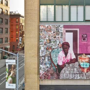 "Painting entitled ""From Lagos to New York"" by Nigerian artist Njideka Akunyili Crosby that shows a mural of a Black woman on the side of a building in New York city"