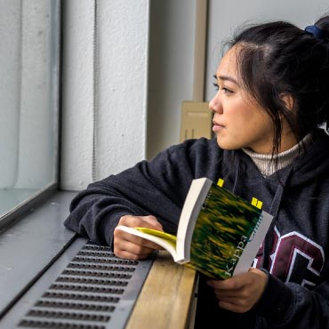 student looking out a window