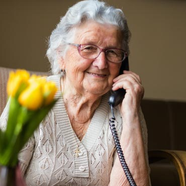 a senior speaking on the phone